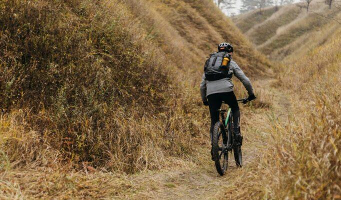 man-riding-bike-mountain-path (2) (1)