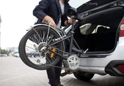 young-man-using-folding-bike-city